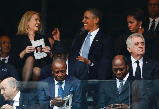"""Mrs. Obama contemplating cramming some """"smart diplomacy"""" in her husband's hindquarters..."""