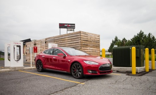 Tesla Model S and Supercharger station. credit: caranddriver.com