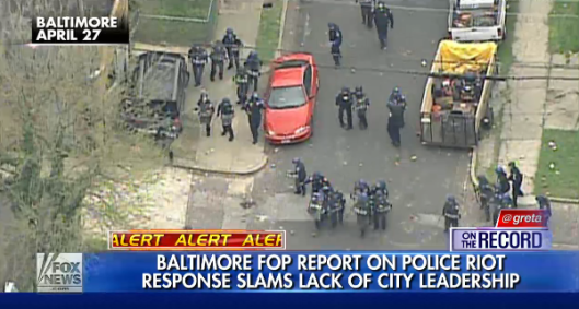 Baltimore officers, unable to make arrests, forced to retreat under a barrage of rocks, bottles and concrete blocks.