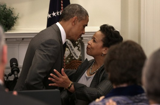 Barack Obama and Loretta Lynch about to engage in social justice. credit: zimbio.com