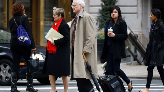 Prosecutors Michael Schatzow (umbrella) and Janice Bledsoe (red scarf)