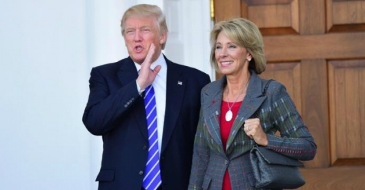 Donald Trump and Betsy DeVos credit: commondreams.com